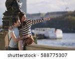 happy tourist couple in love... | Shutterstock . vector #588775307