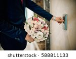 the groom with a bouquet | Shutterstock . vector #588811133