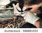 master tattoo artist in gloves... | Shutterstock . vector #588881453