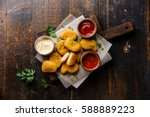 chicken breast nuggets with... | Shutterstock . vector #588889223