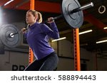 woman in gym lifting weights on ... | Shutterstock . vector #588894443