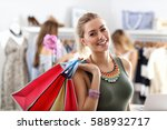 happy woman shopping for clothes | Shutterstock . vector #588932717