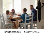 family at home in eating meal... | Shutterstock . vector #588940913