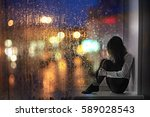 sad young adult woman sitting... | Shutterstock . vector #589028543