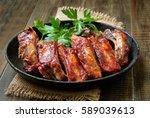roasted pork ribs in frying pan | Shutterstock . vector #589039613