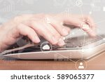 female hand typing on laptop...   Shutterstock . vector #589065377