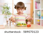 kid little girl eats vegetarian ... | Shutterstock . vector #589070123