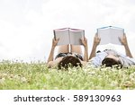 relaxed young couple reading... | Shutterstock . vector #589130963