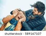 handsome man surprising his... | Shutterstock . vector #589167107