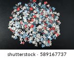 pile of puzzle pieces  | Shutterstock . vector #589167737