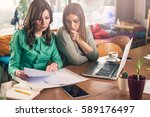 female coworkers working... | Shutterstock . vector #589176497