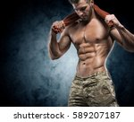 muscular young man in studio on ... | Shutterstock . vector #589207187