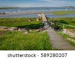 boardwalk on scenic beach | Shutterstock . vector #589280207