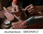 shoemaker  stitching of a... | Shutterstock . vector #589290917