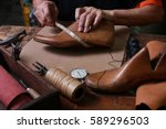 shoemaker measuring a shoe with ... | Shutterstock . vector #589296503