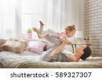 happy loving family. young... | Shutterstock . vector #589327307