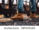 Man Wearing Boots Standing On...