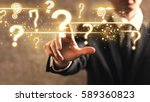 Question Marks With Businessma...