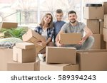 happy family with cardboard... | Shutterstock . vector #589394243