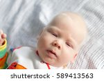 Small photo of Albino. Cute little baby boy with albinism syndrome.