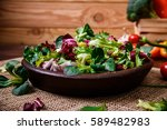 provence mix salad. leaves of... | Shutterstock . vector #589482983