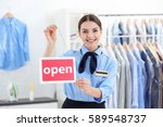 female worker holding board in... | Shutterstock . vector #589548737