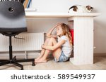 sad child at home. abuse.... | Shutterstock . vector #589549937
