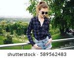 summer fashion portrait of... | Shutterstock . vector #589562483