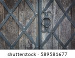 an old wooden gate is decorated ... | Shutterstock . vector #589581677