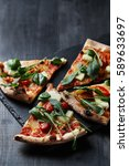delicious pizza on the table | Shutterstock . vector #589633697