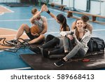 smiling young sporty people... | Shutterstock . vector #589668413