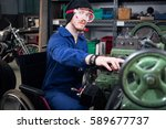 young mechanic apprentice in... | Shutterstock . vector #589677737
