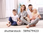 parents with children and cat... | Shutterstock . vector #589679423