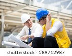 engineers sitting in front of... | Shutterstock . vector #589712987
