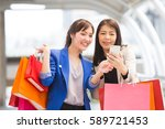 happy shopping asia woman use... | Shutterstock . vector #589721453