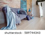 soft blankets hang from violet... | Shutterstock . vector #589744343