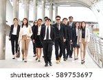 asian business team walking ... | Shutterstock . vector #589753697
