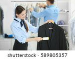 people working in dry cleaning...   Shutterstock . vector #589805357