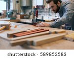 young carpenter working | Shutterstock . vector #589852583