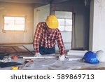Small photo of engineering man technicians or check drawings on the table temporarily. Construction Site Before sending the job to the team in each division. To ensure a successful event with confidence and good.