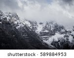 Small photo of Mountain. Top view in the snow with fog, Italian Alps. Weathet, snow, beautiful alpine landscape alpinism ski