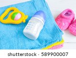 baby bottle with milk and towel ... | Shutterstock . vector #589900007