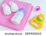 baby bottle with milk and towel ... | Shutterstock . vector #589900043