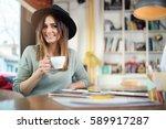 young happy businesswoman... | Shutterstock . vector #589917287