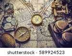 compass  sextant and old coins... | Shutterstock . vector #589924523