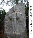 Small photo of Bangalore, Karnataka, India - July 5, 2009 White, grey color stone carved statue of Lord Brahma at Ragigudda Anjaneya Temple