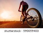 asian men are cycling road bike ... | Shutterstock . vector #590059403