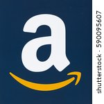 Small photo of MONTREAL, CANADA - FEBRUARY 28, 2017: Amazon logo printed on a blue paper. Amazon is an American electronic commerce and cloud computing company that was founded on July 5, 1994 by Jeff Bezos.