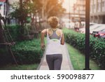 young woman running in the park ... | Shutterstock . vector #590098877