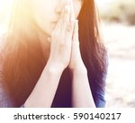 Woman Praying In Meadow At...